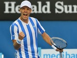 Tomas Berdych celebrates after his win over Kevin Anderson in their Australian Open fourth round match on January 19, 2014