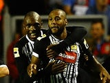 Yoann Arquin of Notts County is congratulated on his goal during the Capital One Cup Second Round between Liverpool and Notts County at Anfield on August 27, 2013