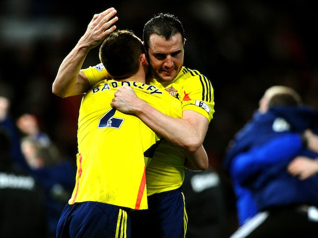 John O'Shea and Phil Bardsley of Sunderland celebrate following their team's 2-1 victory following the penalty shootout during the Capital One Cup semi final against Man Utd on January 22, 2014
