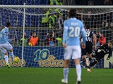 Lazio's midfielder Antonio Candreva (L) scores a penalty kick during the Italian Serie A football match Lazio vs Juventus at Olympic stadium in Rome on January 25, 2014
