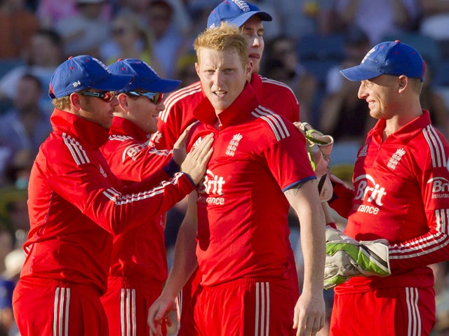 England's bowler Ben Stokes celebrates with teammates Jafter dismissing Australian batsman Glenn Maxwell during the fourth one day international cricket match of the series between Australia and England in Perth on January 24, 2014