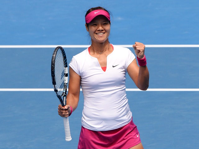 China's Li Na celebrates after victory in her women's singles match against Italy's Flavia Pennetta on day nine at the 2014 Australian Open tennis tournament in Melbourne on January 21, 2014