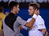 Switzerland's Stanislas Wawrinka shakes hands as he celebrates after victory in his men's singles match against Serbia's Novak Djokovic on day nine at the 2014 Australian Open tennis tournament in Melbourne on January 21, 2014