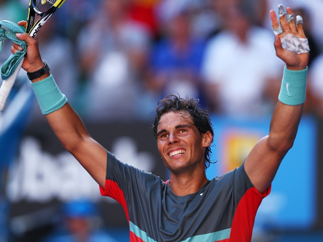 Rafael Nadal of Spain celebrates winning his quarterfinal match against Grigor Dimitrov of Bulgaria during day 10 of the 2014 Australian Open at Melbourne Park on January 22, 2014