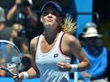 Poland's Agnieszka Radwanska celebrates after victory in her women's singles match against Belarus's Victoria Azarenka on day ten of the 2014 Australian Open tennis tournament in Melbourne on January 22, 2014