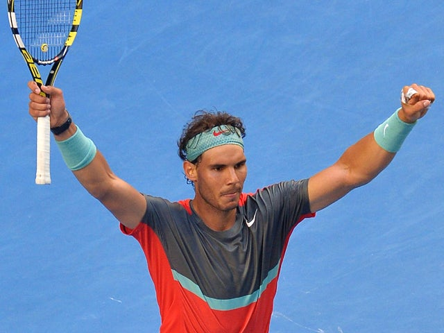 Spain's Rafael Nadal celebrates after victory in his men's singles match against Japan's Kei Nishikori on day eight of the 2014 Australian Open tennis tournament in Melbourne on January 20, 2014