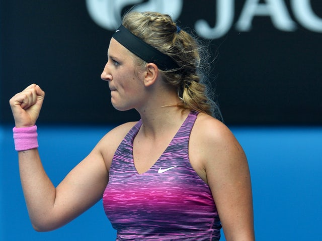 Belarus's Victoria Azarenka celebrates after victory in her women's singles match against Sloane Stephens of the US on day eight of the 2014 Australian Open tennis tournament in Melbourne on January 20, 2014