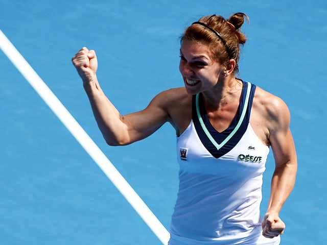 Simona Halep of Romania celebrates her win over Jelena Jankovic of Serbia during their women's singles match on day eight of the 2014 Australian Open tennis tournament in Melbourne on January 20, 2014