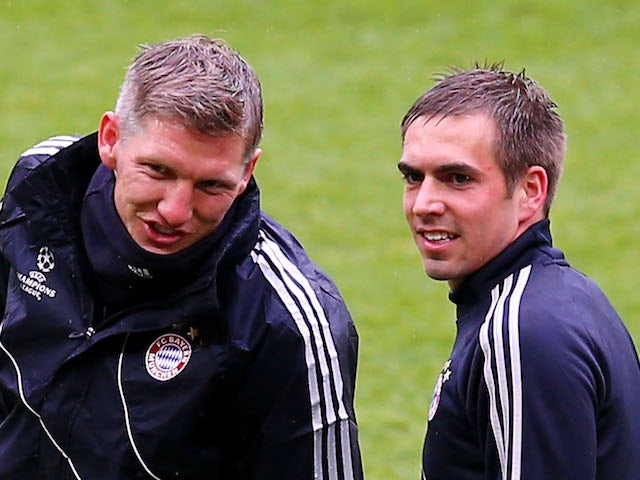 Bastian Schweinsteiger of Bayern Muenchen (C) and team-mate Philipp Lahm during a FC Bayern Muenchen training session ahead of the UEFA Champions League final match against Borussia Dortmund on May 24, 2013