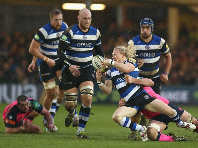 Tom Biggs of Bath looks to offload during the LV Cup match between Bath and Cardiff Blues at the Recreation Ground on January 25, 2014