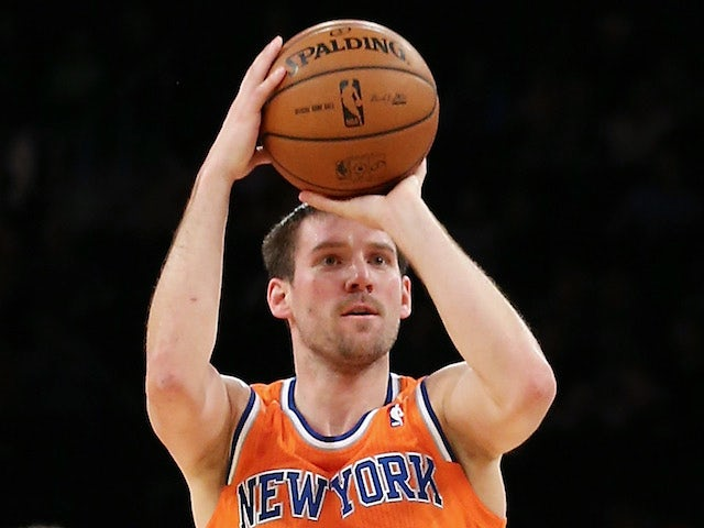 Beno Udrih of the New York Knicks takes a shot against the Boston Celtics at Madison Square Garden on December 8, 2013
