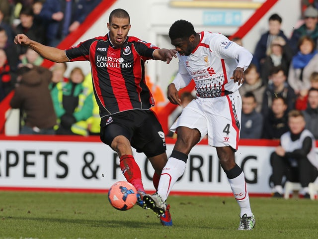 Bournemouth's Lewis Grabban vies with Liverpool's Ivorian defender Kolo Toure during the English FA Cup fourth round football match between AFC Bournemouth and Liverpool at Dean Court in Bournemouth on January 25, 2014