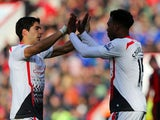 Daniel Sturridge of Liverpool celebrates scoring their second goal with Luis Suarez of Liverpool during the FA Cup Fourth Round match between Bournemouth and Liverpool at Goldsands Stadium on January 25, 2014