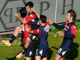 Marco Sau of Cagliari celebrates with teammates after scoring the opening goal during the Serie A match between Cagliari Calcio and AC Milan at Stadio Sant'Elia on January 26, 2014