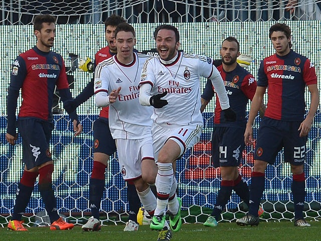 AC Milan's forward Giampaolo Pazzini celebrates after scoring during the Italian Serie A football match between Cagliari and AC Milan on January 26, 2014