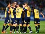 Anthony Caceres of the Mariners celebrates with team mates after scoring the opening goal during the round 16 A-League match between the Central Coast Mariners and the Newcastle Jets at Bluetongue Stadium on January 25, 2014