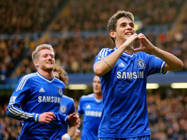 Oscar of Chelsea celebrates scoring the first goal during the FA Cup Fourth Round between Chelsea and Stoke City at Stamford Bridge on January 26, 2014