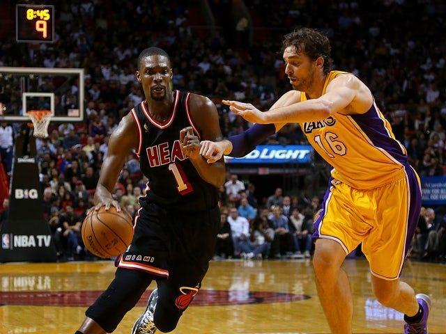 Chris Bosh #1 of the Miami Heat posts up Pau Gasol #16 of the Los Angeles Lakers during a game at American Airlines Arena on January 23, 2014