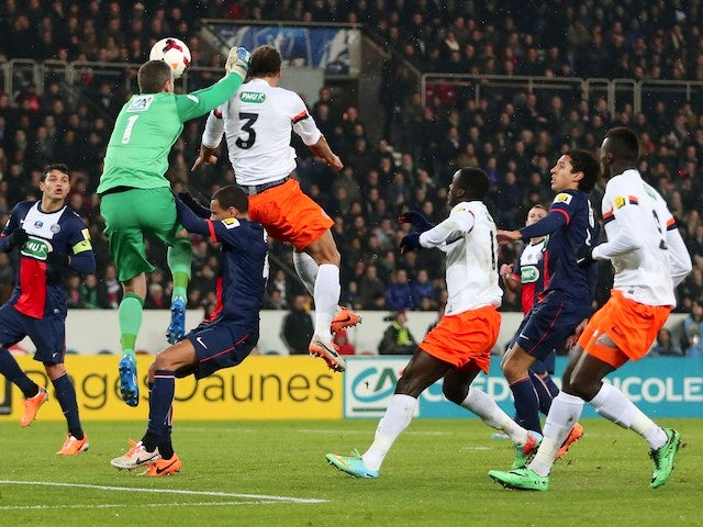 Montpellier's French defender Daniel Congre scores during a French Cup football match Paris Saint-Germain (PSG) vs Montpellier (MHSC), on January 22, 2014