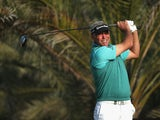 Darren Clarke of Northern Ireland hits his tee-shot on the 14th hole during the first round of the Abu Dhabi HSBC Golf Championship at the Abu Dhabi Golf Cub on January 16, 2014