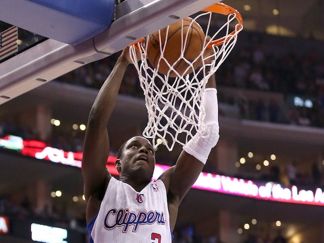 Darren Collison #2 of the Los Angeles Clippers dunks against the Oklahoma City Thunder at Staples Center on November 13, 2013