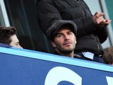 Former Manchester United English midfielder David Beckham attend the the English Premier League football match between Chelsea and Manchester United at Stamford Bridge in London on January 19, 2014