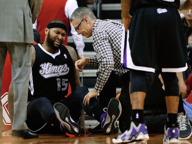 DeMarcus Cousins #15 of the Sacramento Kings sits on the court after a hard foul during the game against the Houston Rockets at the Toyota Center on January 22, 2014