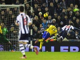 West Brom's Diego Lugano heads in the equalising goal against Everton during their Premier League match on January 20, 2014