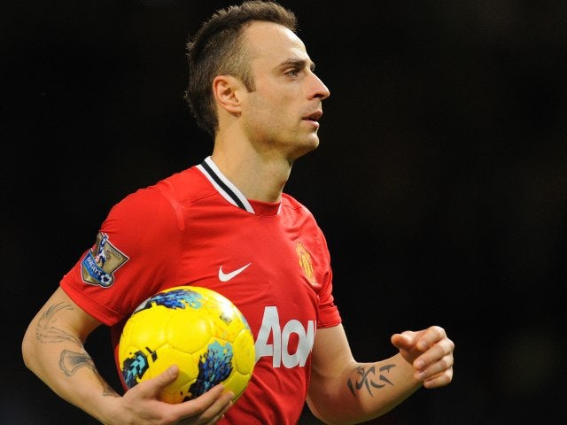Dimitar Berbatov leaves with the match ball after scoring five goals against Blackburn Rovers on November 26, 2011.