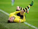 Dortmund's Polish midfielder Jakub Blaszczykowski lies on the pitch during the German first division Bundesliga football match Borussia Dortmund vs FC Augsburg in the German city of Dortmund on January 25, 2014