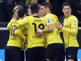Dortmund´s players celebrate during the German first division Bundesliga football match Borussia Dortmund vs FC Augsburg in the German city of Dortmund on January 25, 2014