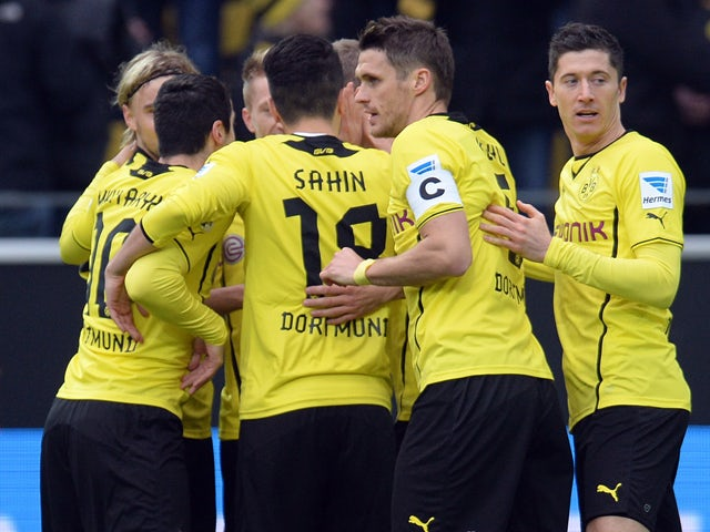 Dortmund�s players celebrate during the German first division Bundesliga football match Borussia Dortmund vs FC Augsburg in the German city of Dortmund on January 25, 2014