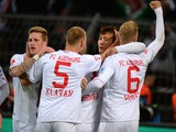 FC Augsburg's players celebrate after scoring during the German first division Bundesliga football match Borussia Dortmund vs FC Augsburg in the German city of Dortmund on January 25, 2014