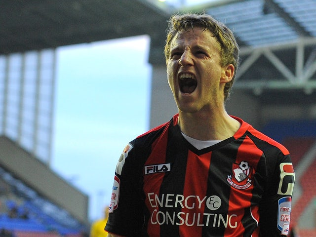 Bournemouth's Irish midfielder Eunan O'Kane celebrates after scoring the opening goal of the English FA Cup third round football match between Wigan Athletic and Bournemouth at The DW Stadium in Wigan, north-west England on January 5, 2013