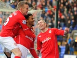 Cardiff City's English forward Fraizer Campbell (C) celebrates after scoring the opening goal with teammates English midfielder Craig Noone (L) and Scottish defender Kevin McNaughton against Bolton on January 25, 2014