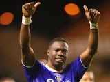 Genseric Kusunga of Oldham celebrates after their victory during the FA Cup First Round Replay match against Wolverhampton Wanderers on November 19, 2013