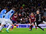 Gerard Pique of FC Barcelona scores the opening goal during the La Liga match between FC Barcelona and Malaga CF at Camp Nou on January 26, 2014