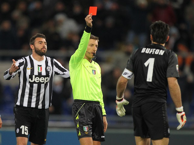 Referee Davide Massa shows the red card to Gianluigi Buffon of Juventus during the Serie A match between S.S. Lazio and Juventus at Stadio Olimpico on January 25, 2014