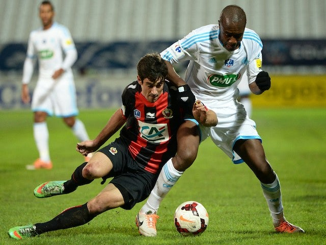 Nice's French defender Gregoire Puel (L) vies with Marseille's French midfielder Gilbert Imbula (R) on January 21, 2014