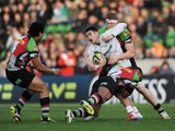 Terrence Hepetema of Leicester Tigers is tackled by Jordan Turner-Hall of Harlequins during the LV= Cup match between Harlequins and Leicester Tigers at Twickenham Stoop on January 25, 2014