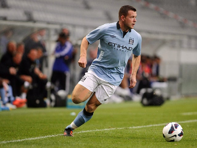 Manchester City's Harry Bunn in action against Al Hilal during a friendly match on July 13, 2012