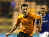 Jake Cassidy of Wolves runs with the ball during the FA Cup First Round Replay match between Wolverhampton Wanderers and Oldham Athletic at Molineux on November 19, 2013