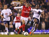 Julio Baptista of Arsenal is challenged by Didier Zokora of Tottenham during the Carling Cup Semi Final 1st leg match on January 24, 2007