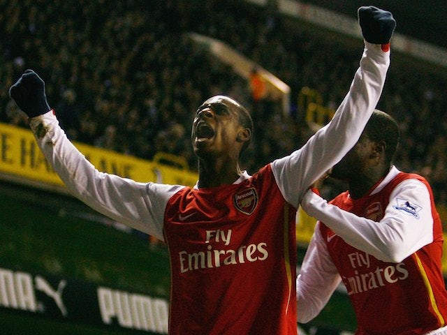 Justin Hoyte (L) of Arsenal celebrates the second Arsenal goal during the Carling Cup Semi Final 1st leg match between Tottenham Hotspur and Arsenal at White Hart Lane on January 24, 2007