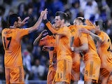 Real Madrid's French forward Karim Benzema is congratulated by his teammates after scoring the opener during the Spanish Copa del Rey quarter-final first-leg football match against Espanyol on January 21, 2014