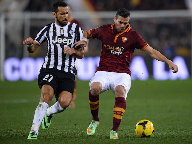 AS Roma's Brazilian defender Leandro Castan fights for the ball against Juventus' forward Fabio Quaglierella during their Coppa Italia football match, on January 21 , 2014