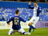 Lee Novak of Birmingham celebrates with teammate Paul Caddis after scoring the opening goal during the FA Cup fourth round match against Swansea City on January 25, 2014