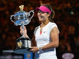 China's Li Na holds the trophy after her victory against Slovakia's Dominika Cibulkova during the women's singles final on day 13 of the 2014 Australian Open tennis tournament in Melbourne on January 25, 2014