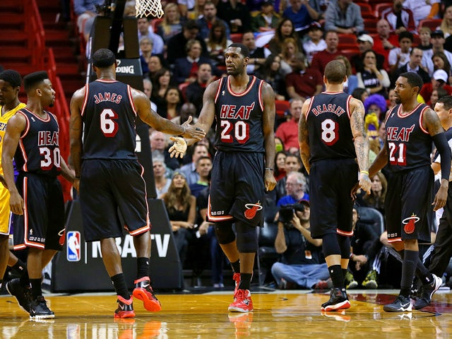 Greg Oden #20 and LeBron James #6 of the Miami Heat high five during a game against the Los Angeles Lakers at American Airlines Arena on January 23, 2014