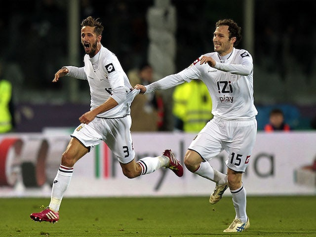 Luca Antonini of Genoa CFC celebrates after scoring their second goal during the Serie A match against ACF Fiorentina on January 26, 2014